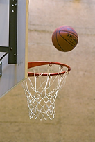 a basketball being shot into a basket