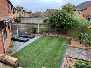 A full garden transformation with grey block paving