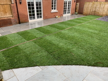 Tiered garden with Indian Sandstone paving