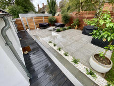 Millboard decking pathway with porcelain paving and contemporay fencing
