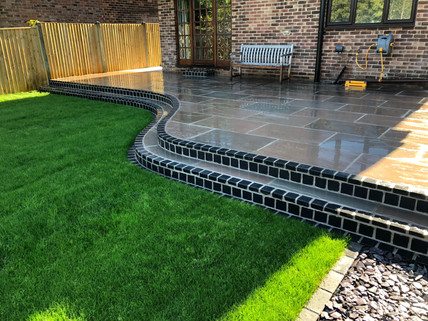 Curved cobble step and Indian Sandstone paving