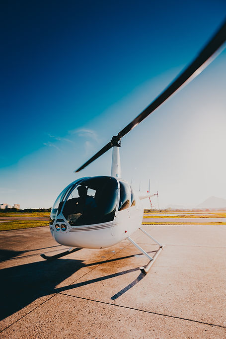 person-riding-white-helicopter-2868226.j