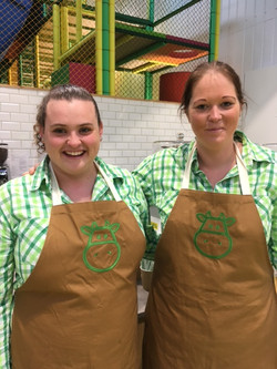 Happy staff in their aprons