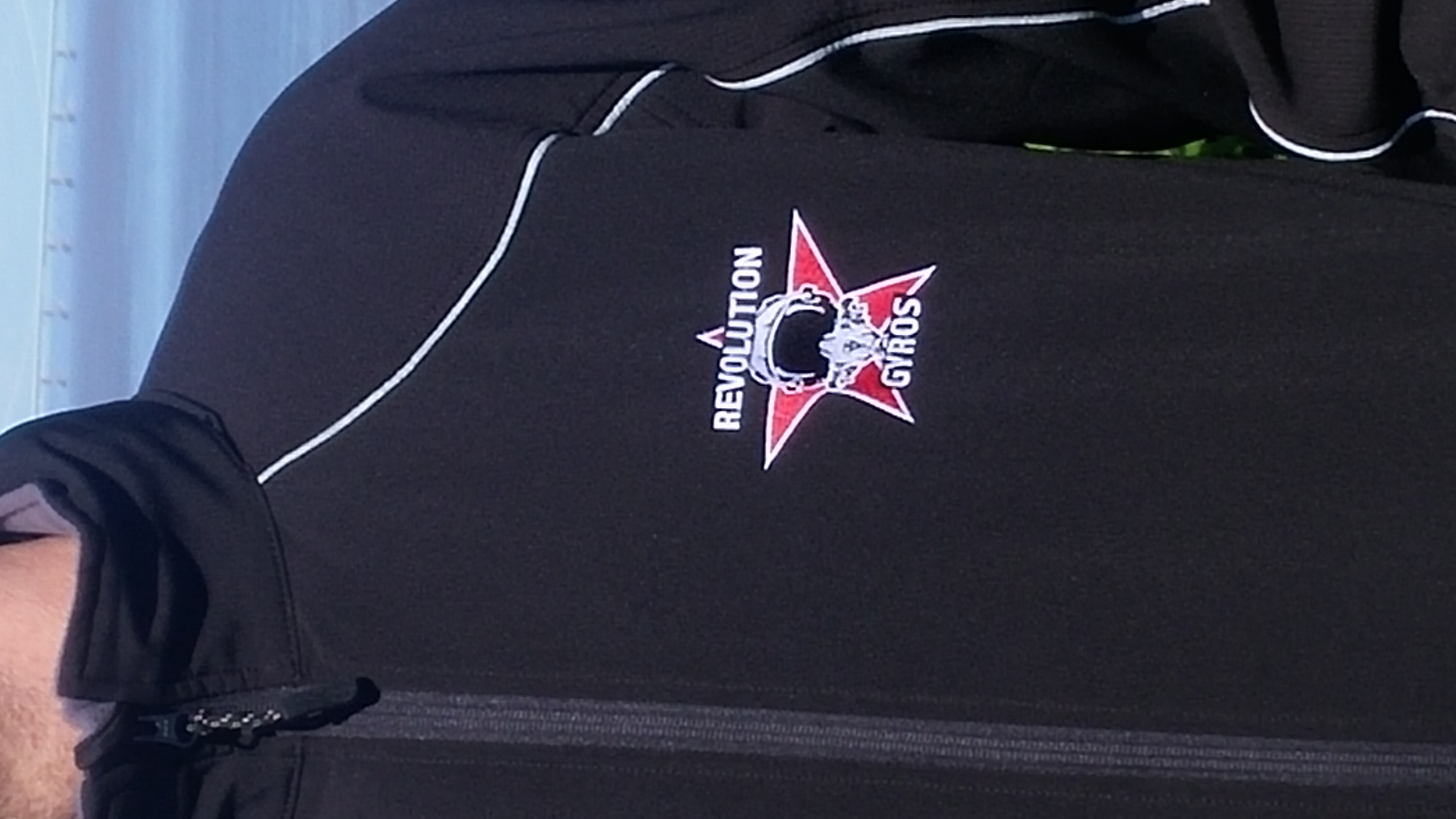 Revolution Gyros chest logo