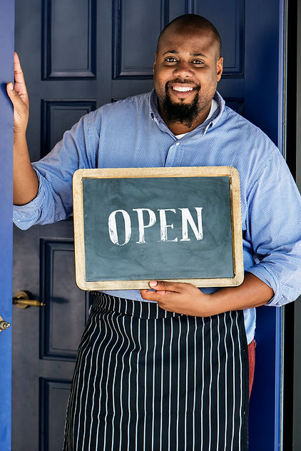 cheerful-small-business-owner-with-open-