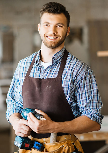 smiling-craftsman-with-electric-drill_ed