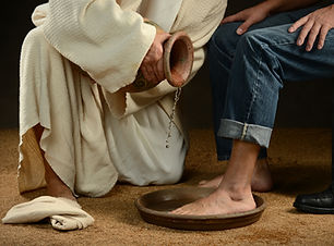 Jesus washing feet of modern man wearing jeans.jpg