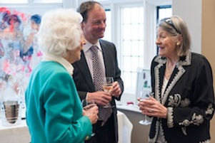 Three guests chatting and drinking wine