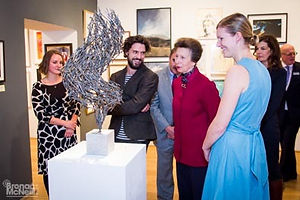 HRH The Princess Royal and others admiring a sculpture