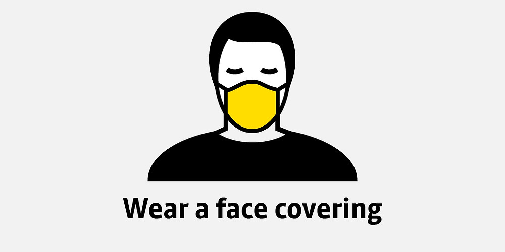 Drawing of man wearing a yellow face covering
