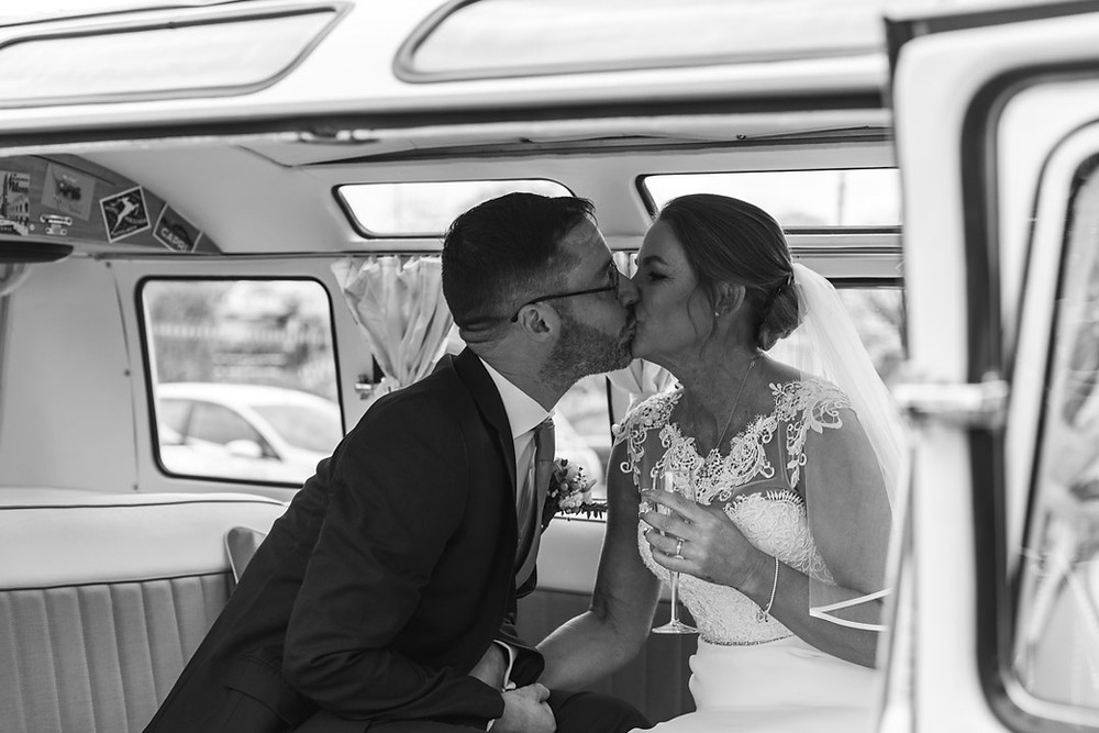 Bride and Groom in a VW Camper Van on their wedding day!