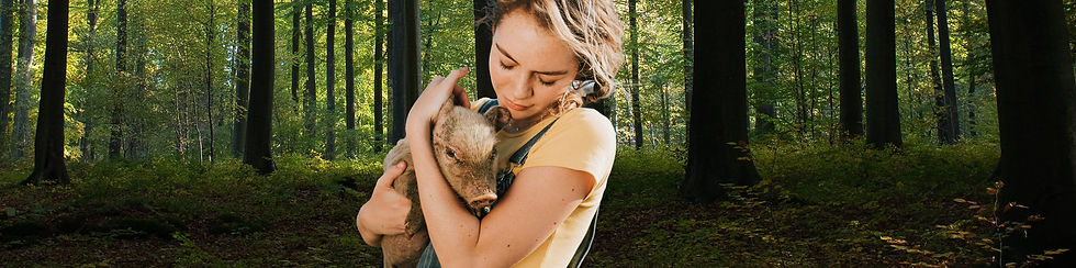 Young girl cuddles piglet with green 5 c