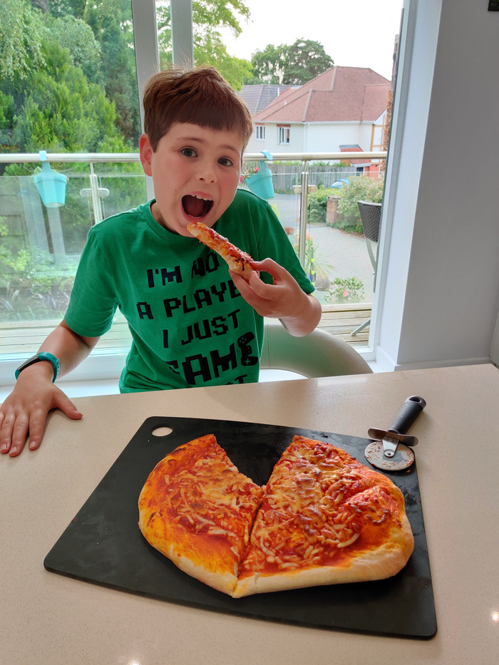 Rory in Year 5 tucking into his pizza.jp