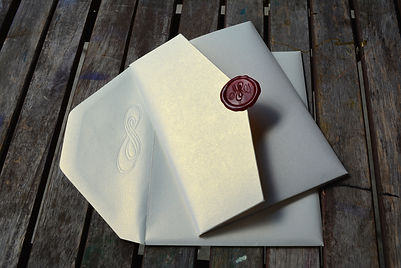 Luxury wedding invitation pocket folder with wax seal and infinity design, by Lucky Invitations. Chicago wedding invitations.