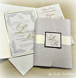 Luxury letterpress custom glitter pocket fold wedding invitation by Lucky Invitations.