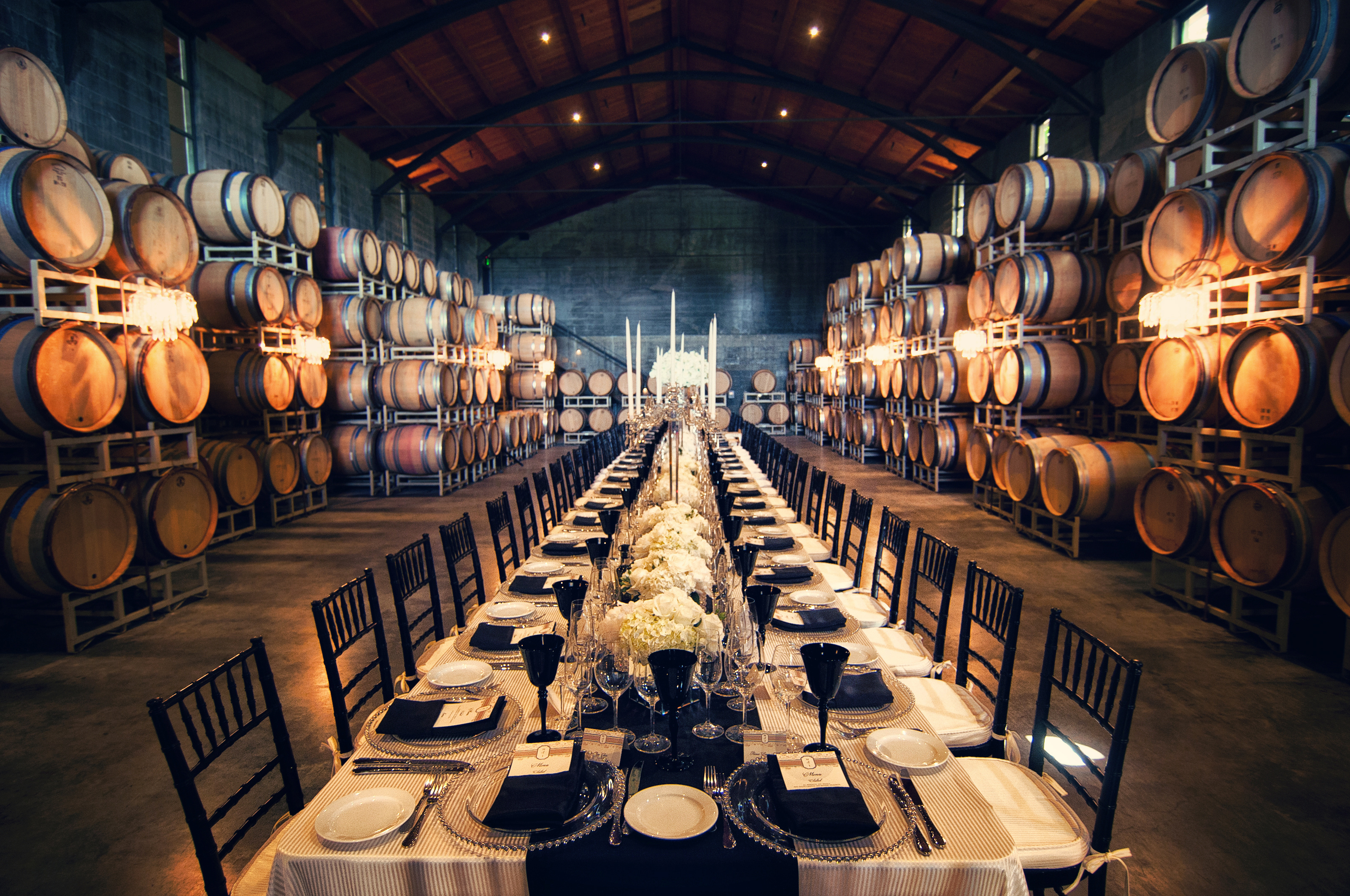 table-setting-at-winery-with-wedding-menus-from-Lucky-Invitations
