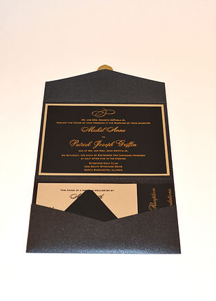 Black and gold pocket fold wedding invitation with letterpress printing, by Lucky Invitations.
