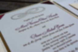 Letterpress wedding invitation with infinity design in merlot ink, by Lucky Invitations. Chicago Wedding Invitations.