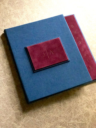 Luxury wedding invitation. Hard cover book style invitation lined in burgundy velvet materal, by Lucky Invitations.