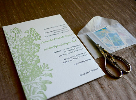 Beautiful letterpress printed floral wedding invitation in pantone greenery, by Lucky Invitations - Chicago.