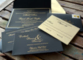 Luxury letterpress wedding invitation suite in gold and black, by Lucky Invitations.