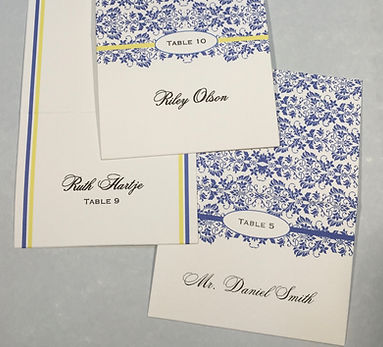 Custom designed escort cards with unique designs indicating menu selection, by Lucky Invitations.