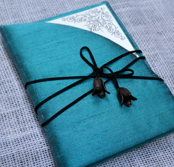 luxury-teal-silk-boxed-wedding-invitation-with curved-cover-by-lucky-invitations