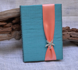 luxury-teal-silk-boxed-wedding-invitation-with-starfish-brooch-by-lucky-invitations