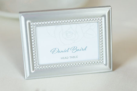 Framed escort card with rose detail, by Lucky Invitations.