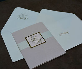 Luxury pink and gold letterpress wedding invitations by Lucky Invitations.