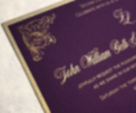 Close up view of letterpress gold ink on purple Plike card stock, by Lucky Invitations