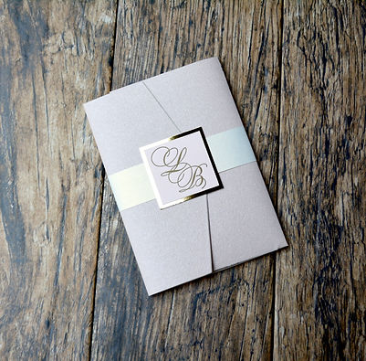 Custom designed letterpress blush and gold wedding invitation by Lucky Invitations.