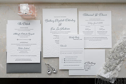 Letterpress wedding invitation suite with rose detail, by Lucky Invitations. Photo by Laura Fisher Photography.