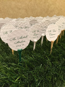 Custom designed and hand crafted golf ball and tee escort cards for wedding reception, by Lucky Invitations.
