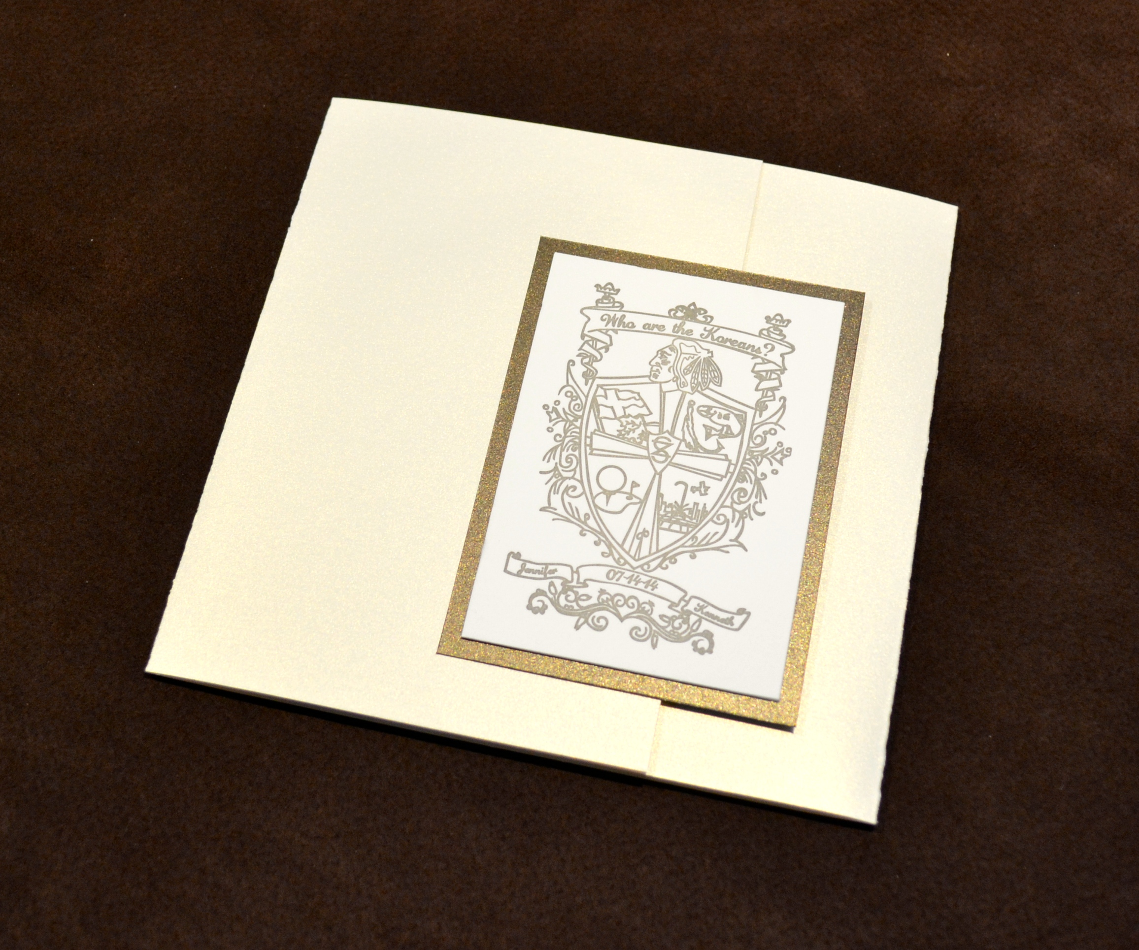 gatefold-wedding-invitation-with-letterpress-crest-design-by-lucky-invitations