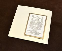 gatefold-wedding-invitation-with-letterpress-crest-design-by-lucky-invitations