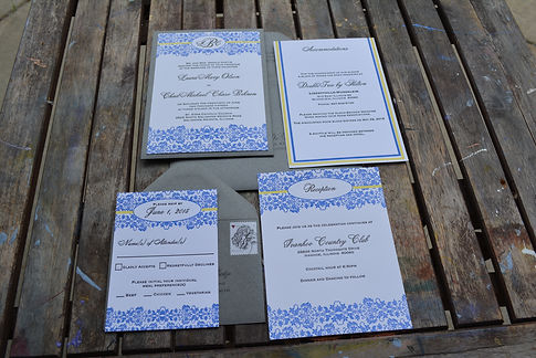 Letterpress wedding invitation suite featuring colorful damask design in blue and yellow, by Lucky Invitations.