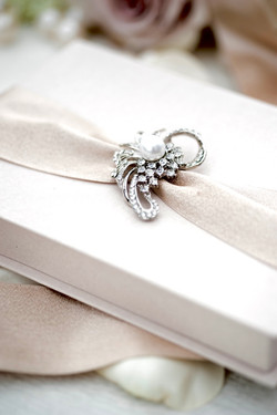 Luxury-blush-boxed-wedding-invitation-with-brooch-by-lucky-invitations