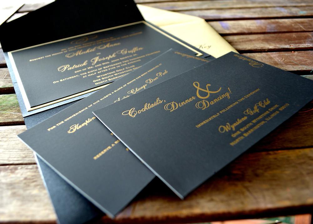 Gold letterpress on luxe black card stock.