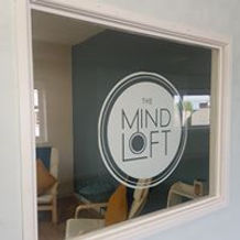 mindloft therapy office window and logo