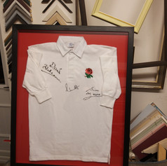 Adult rugby shirt, stitched to conservation board in deep black box frame