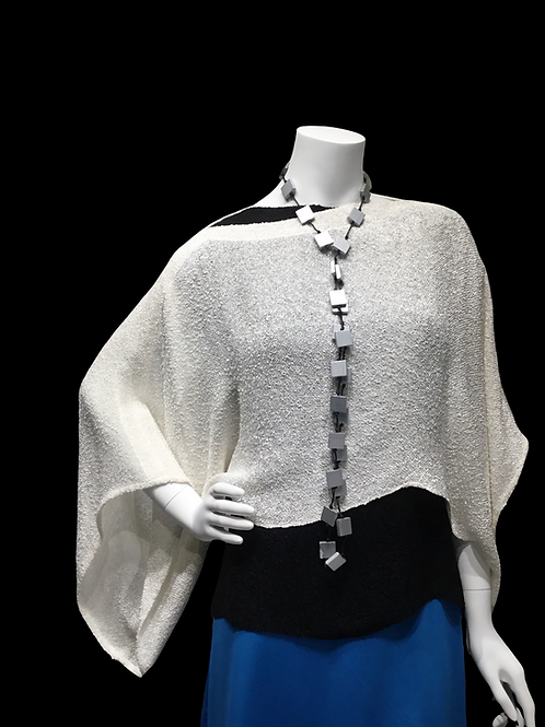 White handwoven sweater with black cap sleeve top with Jianhui necklace
