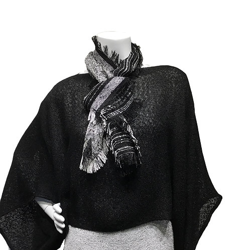 Black handwoven sweater with white cap sleeve top and Black and white Lisa Scarf