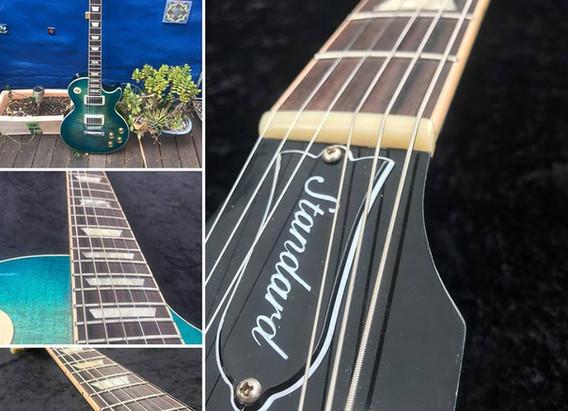 Corcoran Custom Guitars and Repair Service. Bone Nut. Re-fret.