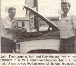 John Timmermans and Ray Wolting,two of the partners in ATW Autmotive Services, test out the natural gas pumps.