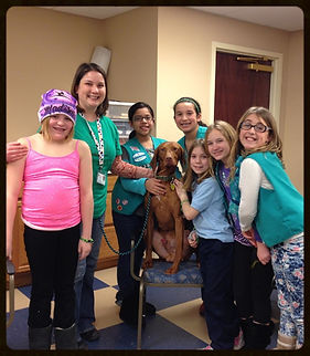 Dog walking at the girl scouts troop