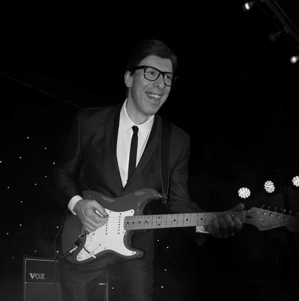 Adam as Hank Marvin