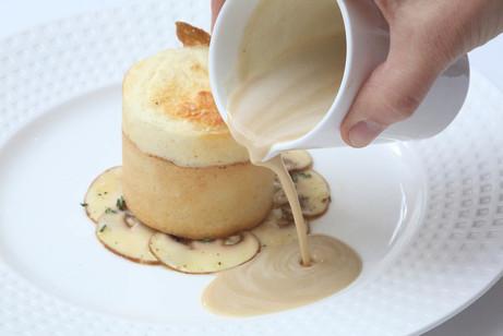 Mushroom souffle with mushroom sauce