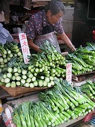 Vietnam market man selling veg.JPG