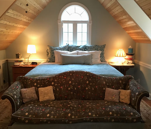 Romantic Master Suite with reclaimed cedar planks on a vaulted ceiling and curved casement window by Architect Mollie Ackner
